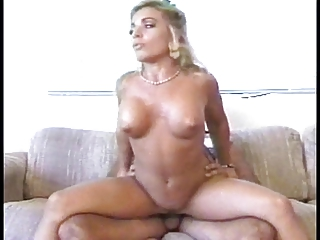 Beautiful, busty blonde gets nailed on the couch, gets a facial