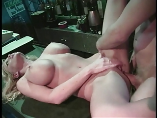 Silicon blonde poledancer sucks dude's big cock