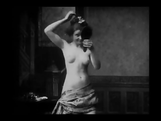 Vintage Erotic Movie 6 -  Seminude Woman combing Hairs 1905