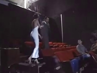 Sexy Couple putting on a show in a Adult Cinema
