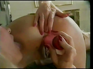 tiny titted lesbian with dildo an strapon